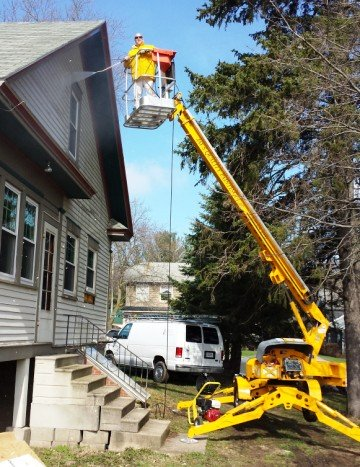 boom lift for pressure washing, painting and repairs